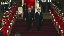 Canada's Prime Minister Stephen Harper, left, is escorted by South Korea's 1st Vice-Foreign Minister Cho Tae-yong upon his arrival for his two-day visit at Seoul military airport in Seongnam, South Korea, on Monday, March 10, 2014. (Choi Jae-gu/Associated Press)