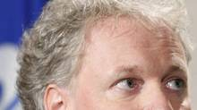 Premier Jean Charest looks on during a news conference at the National Assembly in Quebec City on Aug. 24, 2010. (MATHIEU BELANGER/Reuters)