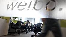Employees work at a Sina Weibo office in Beijing. Weibo followers are commonly bought and sold in China, where companies openly advertise their services. (Alexander F. Yuan/AP)