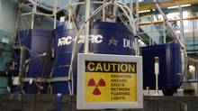 A sign is seen outside the reactor at the Atomic Energy Canada Limited (AECL) Chalk River nuclear facility during a media tour in Chalk River, Ontario, December 19, 2007. (CHRIS WATTIE/REUTERS)