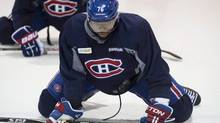 Montreal Canadiens defenceman P.K. Subban stretches during a practice on Wednesday, April 30, 2014 in Brossard, Que. (Paul Chiasson/The Canadian Press)