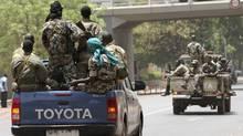 Malian junta soldiers patrol a road in Kati, outside Mali's capital Bamako, April 1, 2012. (Luc Gnago/REUTERS)