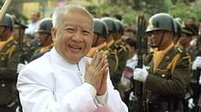 An April 2002 file photo shows Cambodia's then King Norodom Sihanouk outside the royal palace in Phnom Penh. (Chor Sokunthea/REUTERS)
