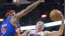 Toronto Raptors forward Hedo Turkoglu (right) drives to the hoop under Detroit Pistons centre Chris Wilcox (9) during first half NBA action in Toronto on Sunday December 27, 2009. THE CANADIAN PRESS/Frank Gunn (FRANK GUNN)