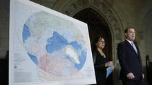 Canada's Foreign Minister John Baird and Environment Minister Leona Aglukkaq walk past an Arctic map while arriving at a news conference on Parliament Hill in Ottawa December 9, 2013. (CHRIS WATTIE/REUTERS)