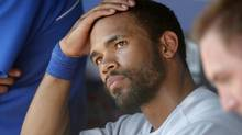Toronto Blue Jays left fielder Eric Thames watches the game against the Texas Rangers from the dugout in the eighth inning of their MLB American League baseball game in Arlington, Texas May 27, 2012. (TIM SHARP/Reuters)