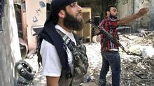 Free Syrian Army fighters in Aleppo are bracing for an assault by government forces. (REUTERS)