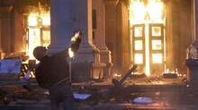 A protester throws a petrol bomb at the trade union building in Odessa on May 2, 2014. (Reuters)