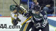 Clarkson's Jamie Lee Rattray, left, fights for a loose puck with Mercyhurst's J'nai Mahadeo during the first period of Clarkson's 5-1 victory in an NCAA college hockey game in the semi-finals of the women's Frozen Four in Hamden, Conn., Friday, March 21. (Fred Beckham/AP)