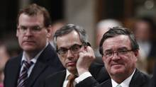 Finance Minister Jim Flaherty (R), Treasury Board President Tony Clement (C) an Foreign Minister John Baird stand to vote on an opposition amendment to the government's omnibus budget bill, in the House of Commons on Parliament Hill in Ottawa June 14, 2012. (Chris Wattie/Reuters)