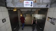 Commuters are photographed heading down to Union Station and transit home on June 14 2012. (Fred Lum/The Globe and Mail)