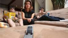 For emergency use only, sits a cell phone which Tammy Jeske gives to her kids Evan,12, left and Jaden,10, for when they're at school only to be used during bus delays, or parent pickups. Tammy has been campaigning to get phones and wi-fi out of schools. (Chad Hipolito for The Globe And Mail/Chad Hipolito for The Globe And Mail)