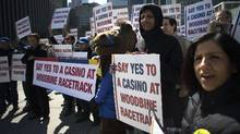 Protesters gathered outside City Hall on Monday as the executive committee debated the merits of a proposed casino for Toronto. (Chris Young For The Globe and Mail)