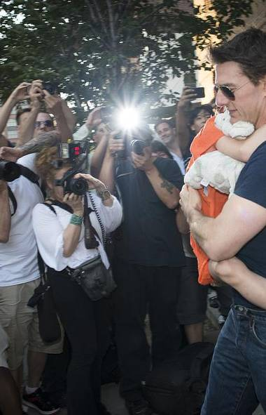 Tom Cruise leaves a New York hotel last week with Suri, the daughter he had been accused in the tabloid press of abandoning in the wake of his split with Katie Holmes. Luckily for Tom, there were a ton of completely unexpected photographers staking out the hotel, which apparently has no back entrance, to take photos that put the lie to the vicious rumour. (Reuters)