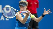 Canada's Eugenie Bouchard returns to Shahar Peer from Israel during first round of play at the Rogers Cup tennis tournament Wednesday in Montreal. Bouchard beat Peer 3-6, 6-2, 7-5. (Paul Chiasson/THE CANADIAN PRESS)