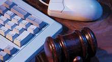 Gavel , computer keyboard and mouse (Comstock/Getty Images/Comstock Images)