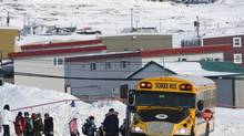 Students board a school bus in Iqaluit. Counsellors and help lines are ready in Nunavut and the Northwest Territories prepare for mandatory classes on residential schools in the very communities where their impact may have been the worst. (NATHAN DENETTE/THE CANADIAN PRESS)