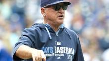 Tampa Bay Rays manager Joe Maddon argues with umpire Bob Davidson after a call at first base was reviewed and overturned in the Toronto Blue Jays favour during fourth inning AL baseball game action in Toronto on Saturday, August 23, 2014. (Fred Thornhill/THE CANADIAN PRESS)