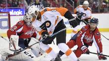 Philadelphia Flyers right wing Wayne Simmonds (17) controls the puck in front of Washington Capitals goalie Braden Holtby (70) and defenseman Karl Alzner (27) during the second period of an NHL hockey game, Saturday, March 4, 2017, in Washington. (Nick Wass/AP)
