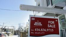 A real estate sign sits on the front lawn of a home on Mechanic Ave. in Toronto on March 3 2014. (Fred Lum/The Globe and Mail)