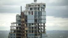 A high rise condominium stands under construction in Toronto, Ontario, Canada, on Friday, May 26, 2017. (Brent Lewin/Bloomberg)