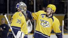 Nashville Predators centre Ryan Johansen, right, congratulates goalie Pekka Rinne after beating the San Jose Sharks on Feb. 6, 2016. Ryan Johansen has come as advertised to Nashville, but the Predators haven't exactly taken off since landing arguably the most dangerous offensive player in team history. (Mark Humphrey/THE ASSOCIATED PRESS)