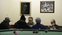 "Members of the Grimethorpe Working Mens Club sit next to a pool table in Grimethorpe, near Barnsley in northern England April 9, 2013. While tributes to former British prime minister Margaret Thatcher poured in from around the world, communities ravaged by the decline of heavy industry during her time in office said they would shed no tears. In Barnsley, a former mining town in northern England, many residents said they would never forgive her for ""decimating mining communities"" after she pushed through policies to close loss-making coal mines in the face of fierce union opposition. Thatcher died on Monday in London after suffering a stroke at the age of 87. Barnsley was once at the heart of Britain's coal industry, surrounded by pits that employed thousands of workers. (NIGEL RODDIS/REUTERS)"