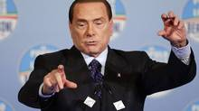 Former Italian prime minister Silvio Berlusconi speaks during political rally in downtown Rome, Jan. 25, 2013. Italy's three-time prime minister, fighting his sixth – and last – campaign, is dominating television and radio channels (many of which he owns) and charming his way back into the imagination of Italians. (MAX ROSSI/REUTERS)