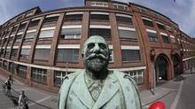 The statue of Adam Opel, founder of German car manufacturer Opel stands in front of the historical headquarters of the company in Ruesselsheim, 20 kilometres from Frankfurt. (KAI PFAFFENBACH/REUTERS)