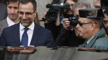 U.S. ambassador in Spain, James Costos (L), leaves the foreign ministry after being summoned to a meeting with Spain's European Secretary of State in Madrid Oct. 28, 2013. (JUAN MEDINA/REUTERS)