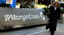 Pedestrians walk past the JP Morgan Chase headquarters in New York in this March 17, 2008 file photo. (Don Emmert/AFP/Getty Images/Don Emmert/AFP/Getty Images)