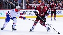 Arizona Coyotes defenseman Jarred Tinordi (28) shoots the puck as Montreal Canadiens left wing Tomas Fleischmann (15) defends during the second period at Gila River Arena. (Matt Kartozian/USA Today Sports)