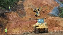 Heavy equipment prepares a road at Inmet's massive Cobre Panama project. Industry experts say Inmet has essentially put itself up for sale, and expect it to start an auction process to attract a bid higher than the $72 per share on offer from First Quantum. (Inmet Mining)