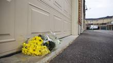 Flowers are left outside of the home where a two-year-old boy died of heat exhaustion on Wednesday after being left unattended in a car in Milton. (Matthew Sherwood for The Globe and Mail)