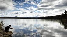 Former Xeni Gwet'in First Nations Chief Roger William stands at the edge of Fish Lake near Williams Lake, B.C., in September 2010. (John Lehmann/The Globe and Mail)