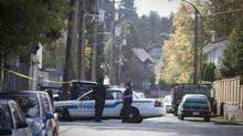 Police at the site of a shooting in Vancouver on September 30, 2009. (John Lehmann/The Globe and Mail)