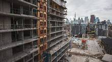 A drop in plans for commercial buildings and multifamily dwellings in Ontario and British Columbia were responsible for much of the December decrease in building permits at the national level. (JENNIFER ROBERTS FOR THE GLOBE AND MAIL)