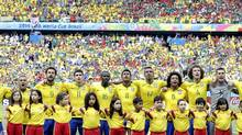 FILE- In this June 17, 2014, file photo, the Brazil national soccer team sings their national anthem before the group A World Cup soccer match between Brazil and Mexico at the Arena Castelao in Fortaleza, Brazil. Brazilian players have started to enter the field with their hands on each other's shoulders. Brazil's team captain Thiago Silva asked the fans to embrace side-by-side while singing, just as the players have been doing. Most of the fans did that in Tuesday's match against Mexico in Fortaleza. (Andre Penner/AP)