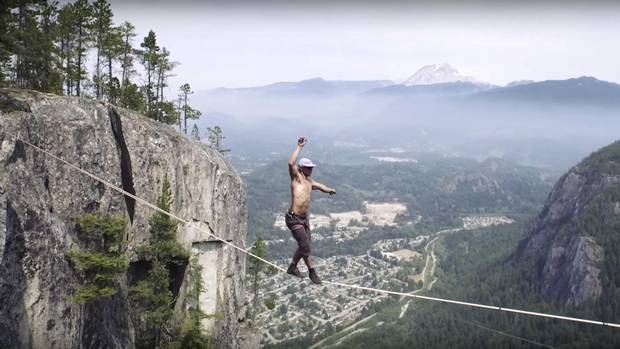 Spencer Seabrooke, the guy who walked the line 290 metres off the ground in Squamish two summers ago without a safety harness - fall off and die. Slacklining for Dave Ebner story in Life.