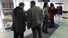 People line up at a Resource Canada office in Montreal. (Ryan Remiorz/Ryan Remiorz/The Canadian Press)