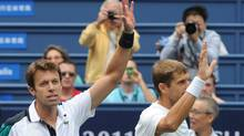 Daniel Nestor of Canada, left, and Max Mirnyi of Belarus. Getty Images (MARK RALSTON)