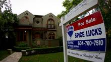 A 'For sale' sign sits on the lawn of a five-bedroom home for sale for more than $3.3-million in the neighborhood of Point Grey in Vancouver on Friday October 7, 2011. (Darryl Dyck For The Globe and Mail/Darryl Dyck For The Globe and Mail)