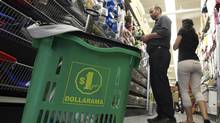 Customes shop at the Dollarama store on Spadina Avenue in Toronto on June 13, 2012. (Deborah Baic/The Globe and Mail)