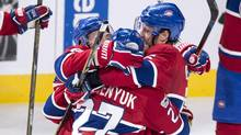 Montreal Canadiens' Shea Weber (right) and Brendan Gallagher (left) hug teammate Alex Galchenyuk after scoring the game-winning goal in overtime against the Columbus Blue Jackets, in Montreal, on Feb. 28, 2017. (Paul Chiasson/THE CANADIAN PRESS)