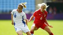 Canada's Kaylyn Kyle and France's Camille Abily challenge for the ball in the women's bronze medal soccer match in Coventry at City of Coventry Stadium at the London 2012 Olympic Games August 9, 2012. (PAUL HACKETT/REUTERS)