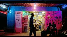 A southern Sudanese walks past a pro-secession poster (L) on the entrance of a general marchandise shop in Juba on January 7, 2011, as one of the world's poorest regions finally prepared to have its say on independence after a 50-year wait with Sudanese President Omar al-Bashir announcing in a television interview that southern Sudanese would be considered foreigners with certain benefits if the south votes for independence. (Yasuyoshi Chiba/AFP/Getty Images/Yasuyoshi Chiba/AFP/Getty Images)
