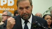 Quebec MP Thomas Mulcair announces his candidacy for the NDP leadership in Montreal on Oct. 13, 2011. (Ryan Remiorz/Ryan Remiorz/The Canadian Press)