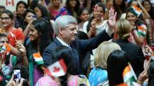 Conservative Leader Stephen Harper waves to attendees during a campaign stop at the BAPS Shri Swaminarayan Hindu temple in Toronto on Monday. (Sean Kilpatrick/The Canadian Press)