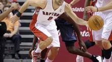 Toronto Raptors guard Jose Calderon takes the ball up court against the Charlotte Bobcats during the first half of their NBA game in Toronto April 3, 2012. (MIKE CASSESE/REUTERS)
