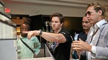 Mark Wahlberg and members of his real-life entourage of Toronto buddies look at the plans for his newly purchased Toronto condo. (Jennifer Roberts for The Globe and Mail/Jennifer Roberts for The Globe and Mail)